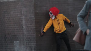 Prankster dressed as 'killer clown' gets knocked out after scaring shoppers in London.